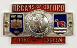 Organs of Oxford St Christopher motor car dealership dashboard badge