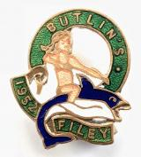 Butlins 1952 Filey holiday camp badge girl riding a fish green labels